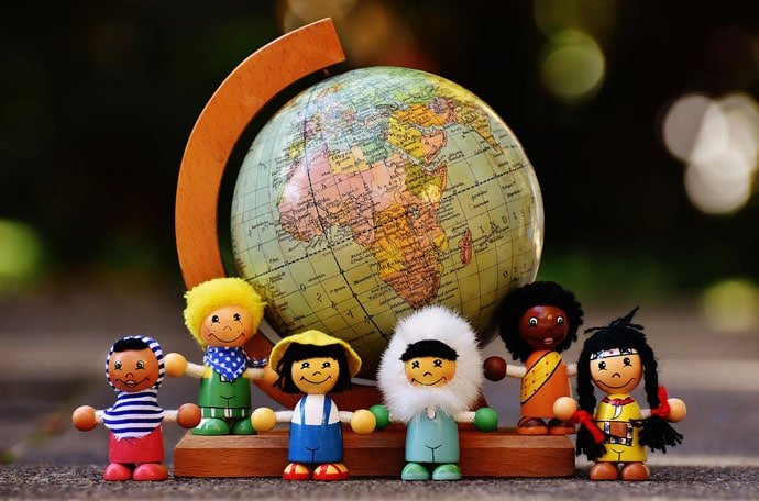 dolls group with world map